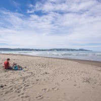 Family enjoying a day at the beach in Mahia
